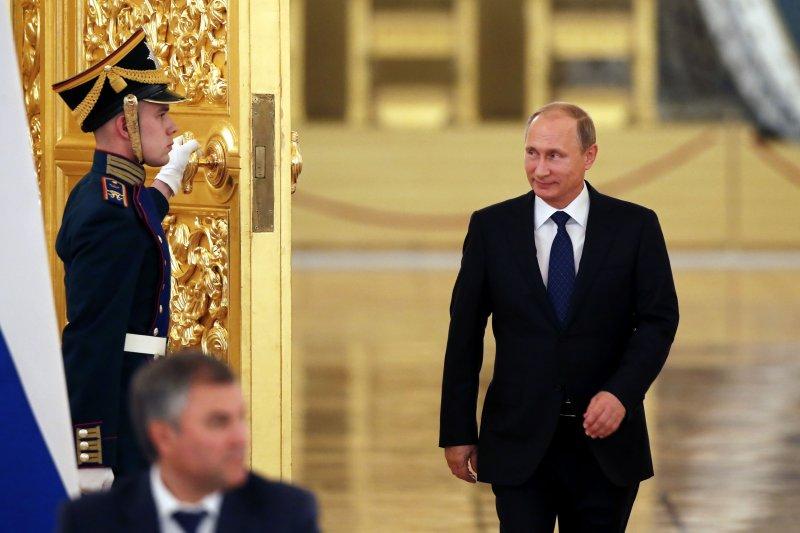 俄羅斯總統普京(右)。(美聯社)
