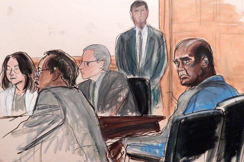 聯合國大會前主席艾希(右)6日因為涉嫌受賄在紐約出庭。(美聯社)