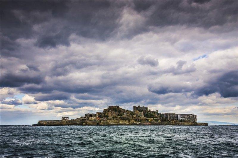 軍艦島在2015年正式成為世界文化遺產。(圖/shutterstock)