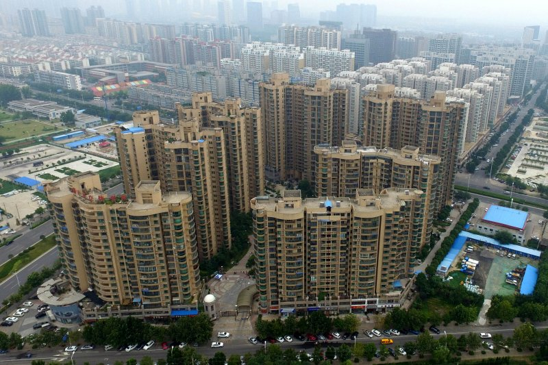 中國房價連年飛漲,民眾為此提高貸款負擔,已經為未來的金融動盪埋下隱患(圖片來源:新華社)