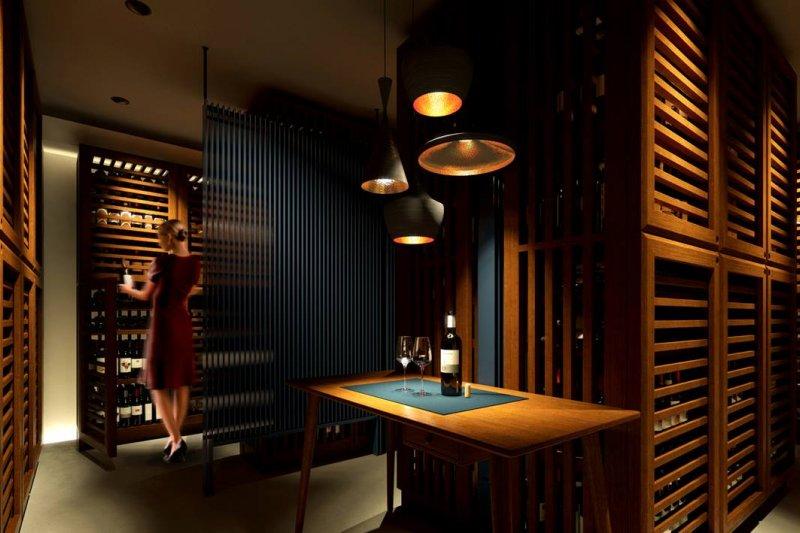 大樓地下室如洞窟般的地下酒窖,宛如秘密基地。(圖/Wine Apartment)
