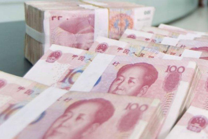 在端午價期過後的首個交易日,昨人民幣兌美元出現猛烈升勢,CNY、CNH分別觸及6.8105、6.7427的6個半月與7個半月新高,媒體稱之為「暴力升值」。(資料照,BBC中文網)