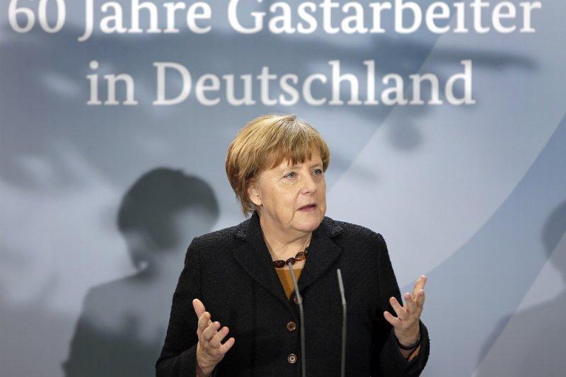 德國總理梅克爾7日在德國移工60周年紀念活動上發表演說。(美聯社)