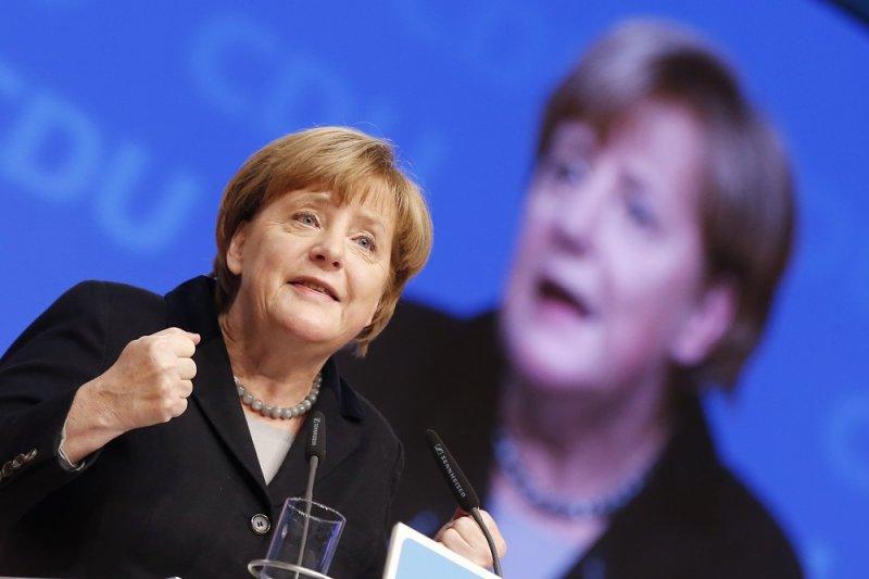 德國總理梅克爾14日於黨會上發表演說(美聯社)