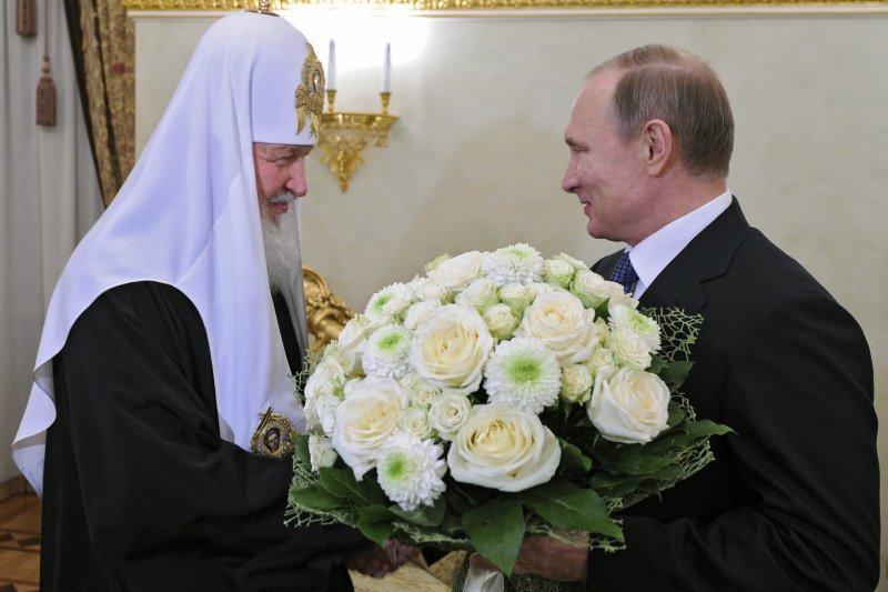 俄羅斯正教會牧首基里爾(Patriarch Kiril)與普京總統(美聯社)