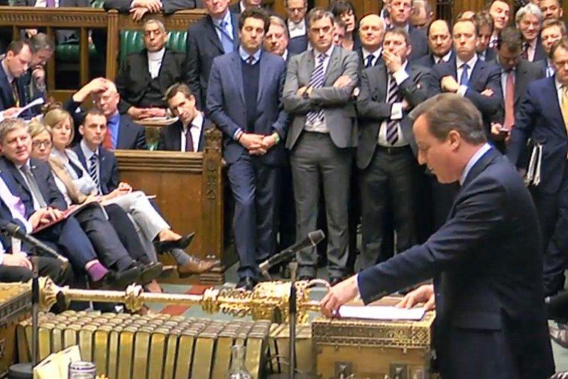 英國首相22日在下議院向國會議員發表演說(美聯社)