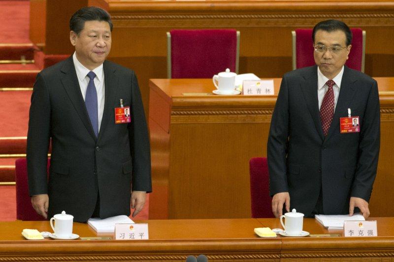 中國12屆全國人民代表大會第四次會議5日在北京人民大會堂揭幕,總書記習近平與總理李克強主持。(美聯社)