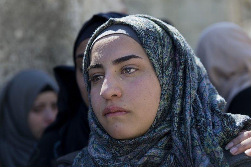 以色列8日連續發生多起攻擊事件,多名巴勒斯坦人被警方擊斃,親人哀悼(美聯社)