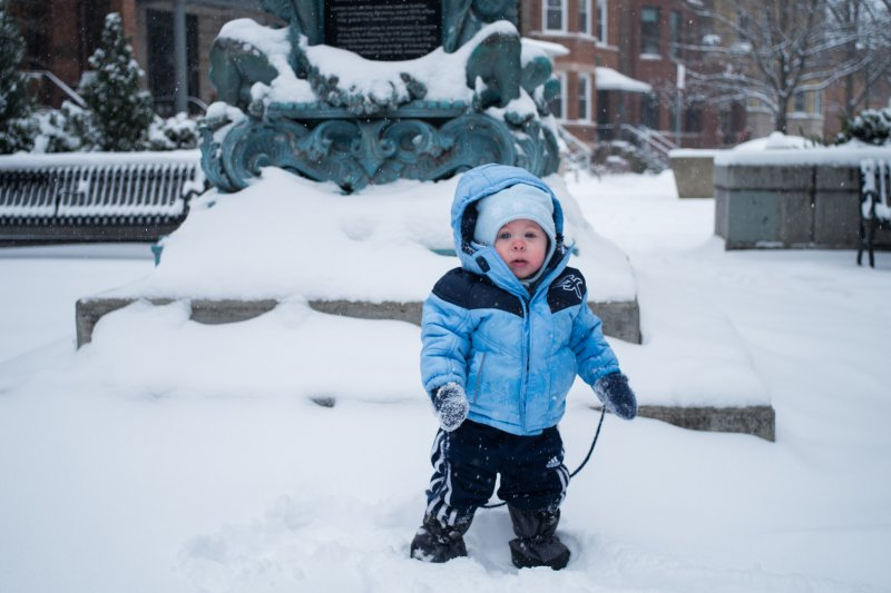 流感肆虐,孩子的抵抗力不比成人,家長要特別注意孩子們的保暖。(圖/Andrew Seaman@facebook)