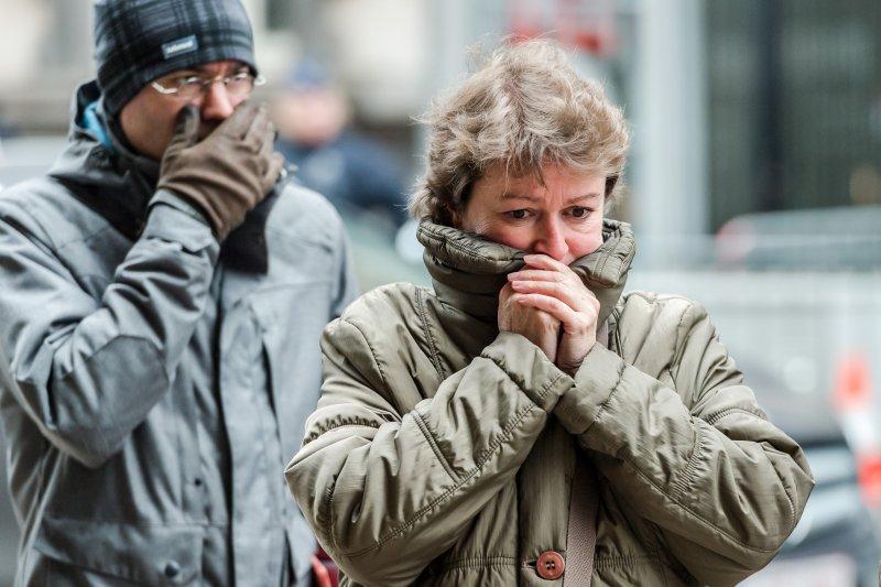 比利時民眾為恐攻遇難者哀悼。(美聯社)