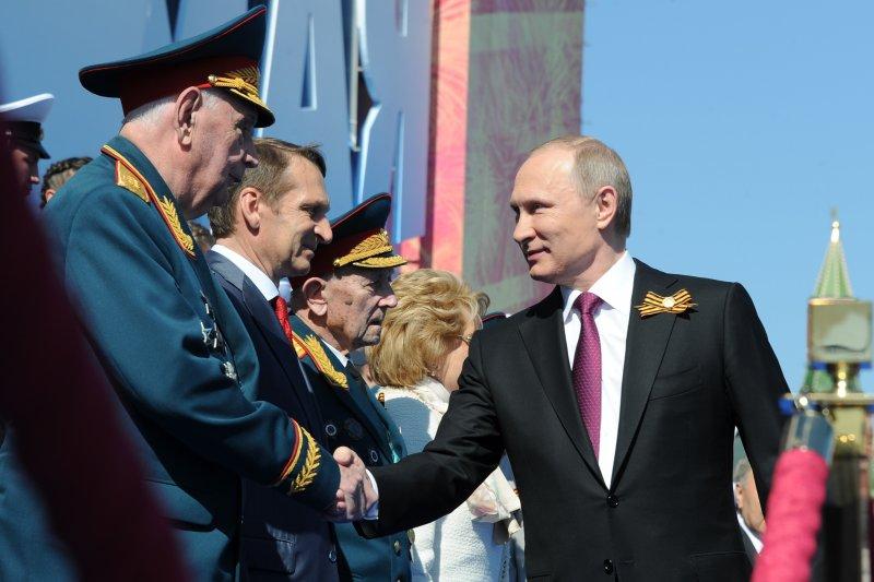 俄國總統普京在紅場閱兵,紀念衛國戰爭勝利71周年。(美聯社)