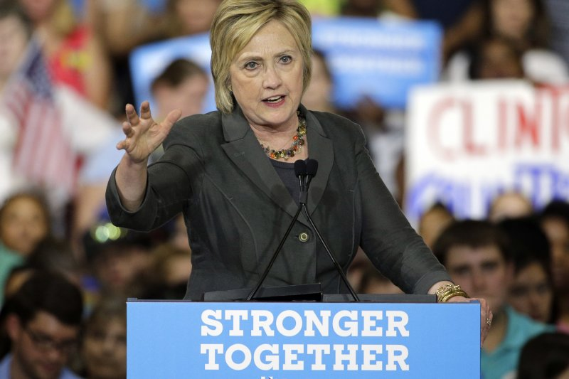 希拉蕊表示將帶領民主黨全體拿回國會多數習次。(圖/美聯社)