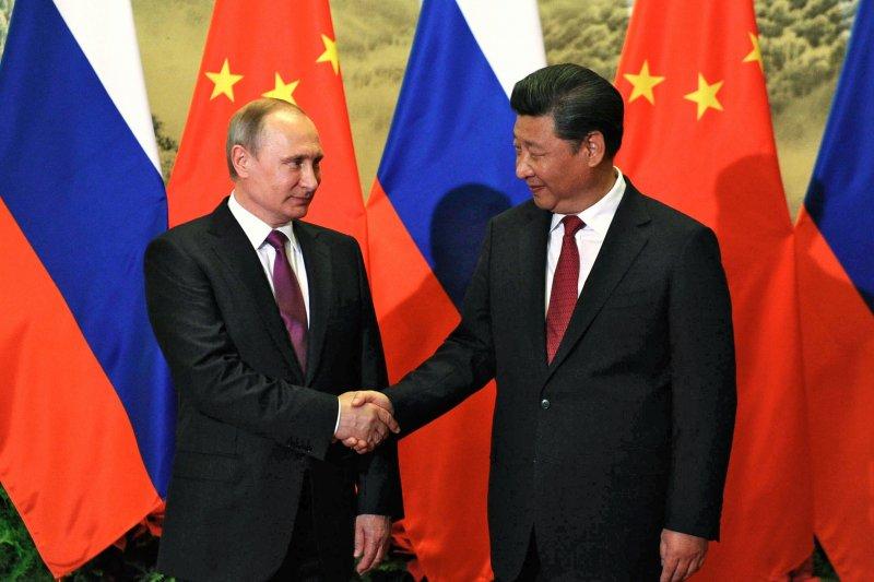 中國國家主席習近平與俄羅斯總統普京在北京會晤。(美聯社)