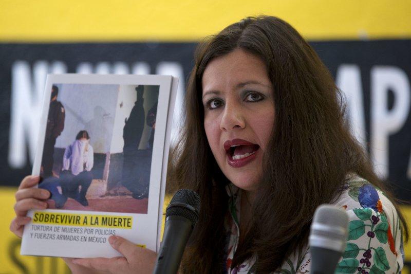 國際特赦組織的美洲主任格瓦拉羅薩斯公佈調查報告。(美聯社)