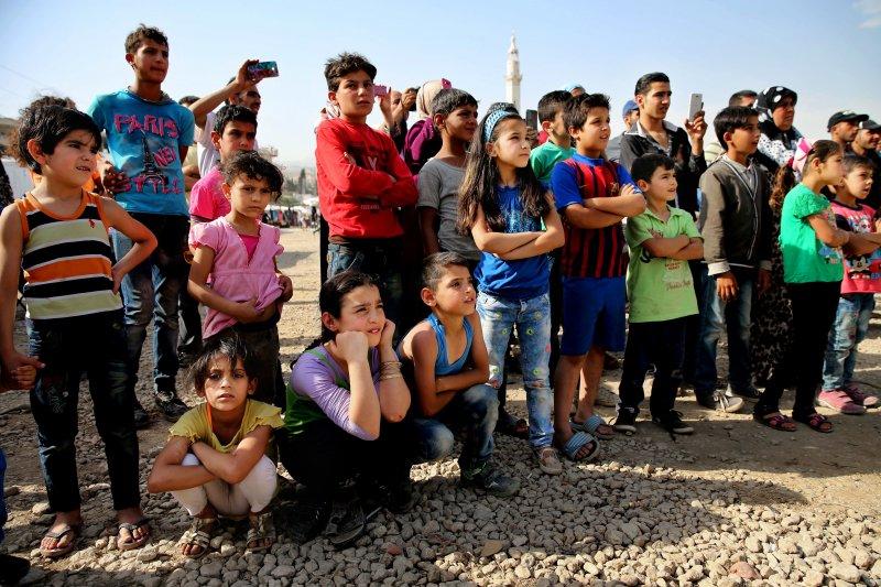 黎巴嫩難民營裡的敘利亞難民兒童。(美聯社)