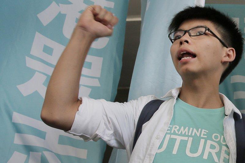 現年僅19歲的黃之鋒,2014年帶領學民思潮和其他團體發起追求真普選運動。(圖/美聯社)