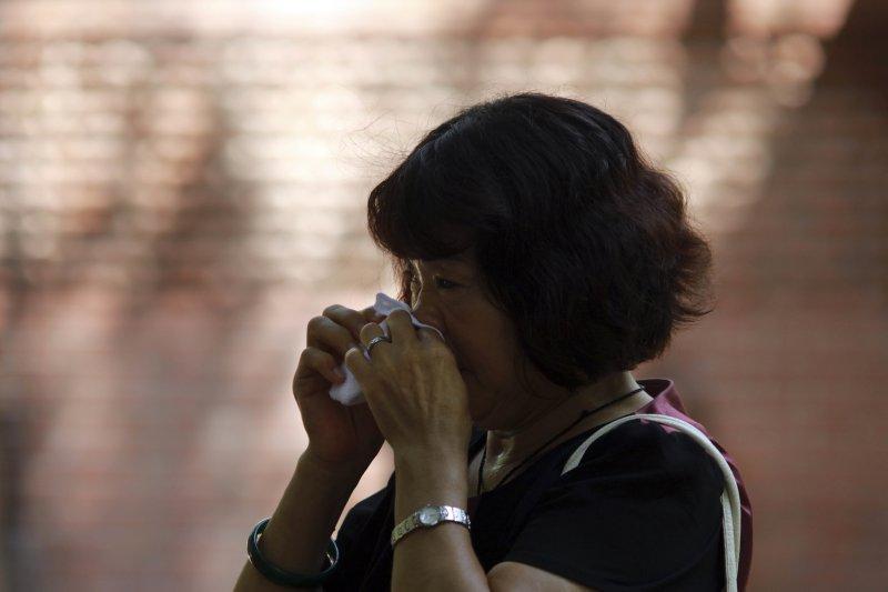 馬來西亞航空公司MH370客機2014年3月失蹤,至今原因不明,家屬早已淚乾(美聯社)