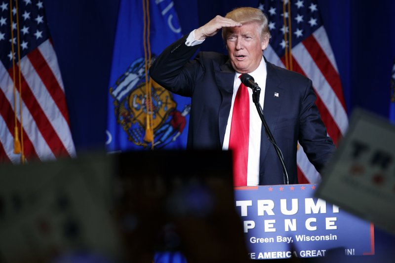 美國共和黨總統候選人川普(Donald Trump)5日出席威斯康辛州綠灣市(Green Bay)的造勢活動(美聯社)