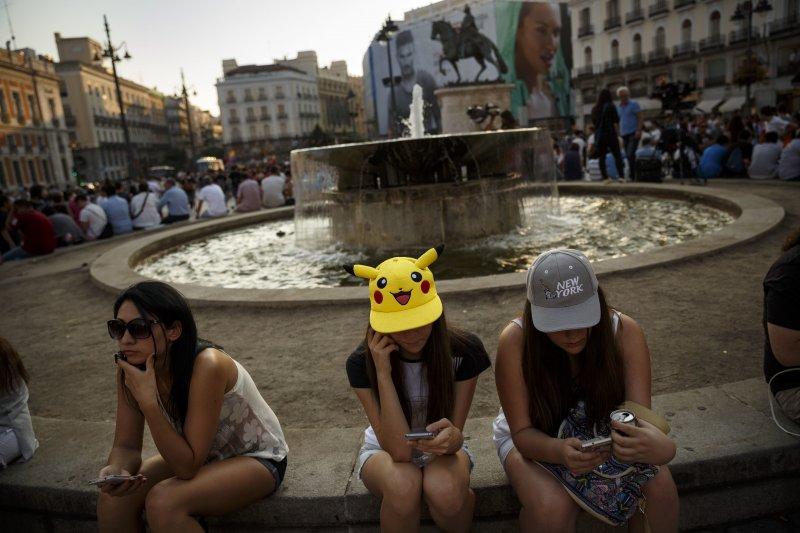手機遊戲《精靈寶可夢GO》(Pokémon GO)熱潮風靡全球(美聯社)