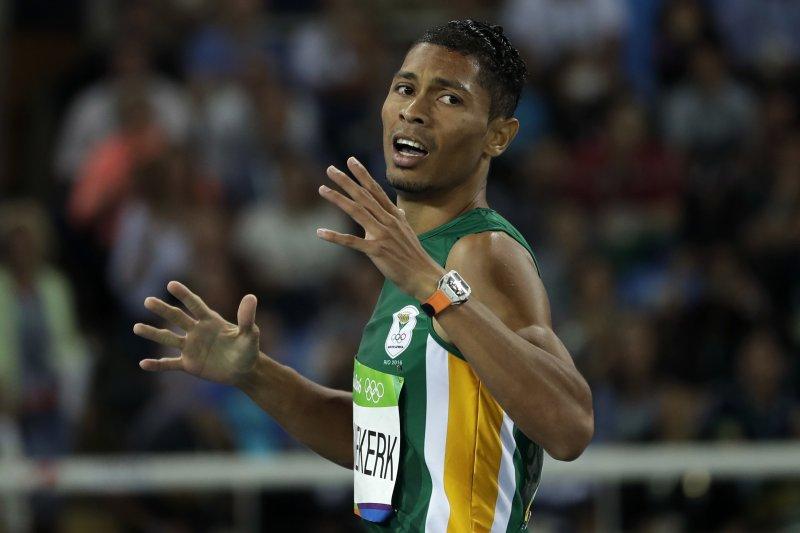 南非短跑小將范尼凱克摘金,成績打破奧運及世界記錄。(美聯社)