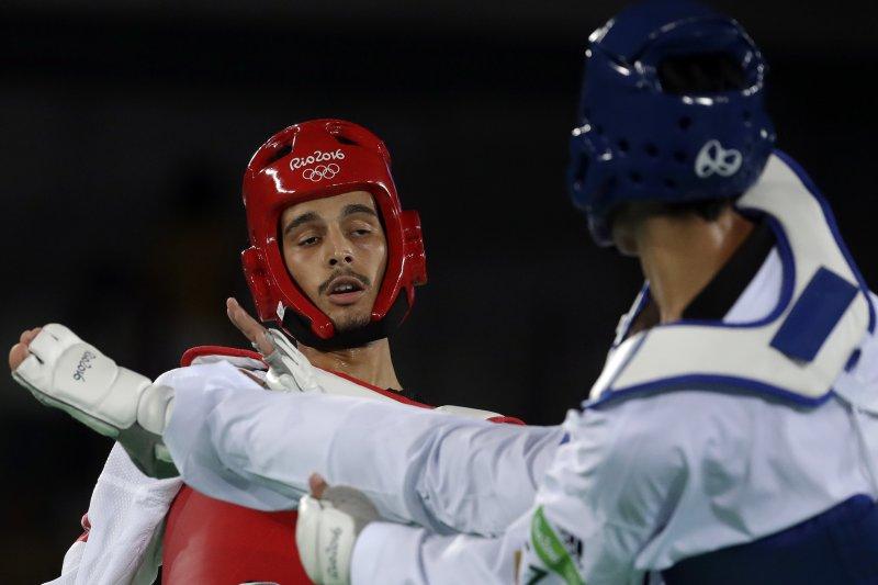 突尼西亞的歐斯拉蒂(Oussama Oueslati)對戰我國選手劉威廷。(美聯社)
