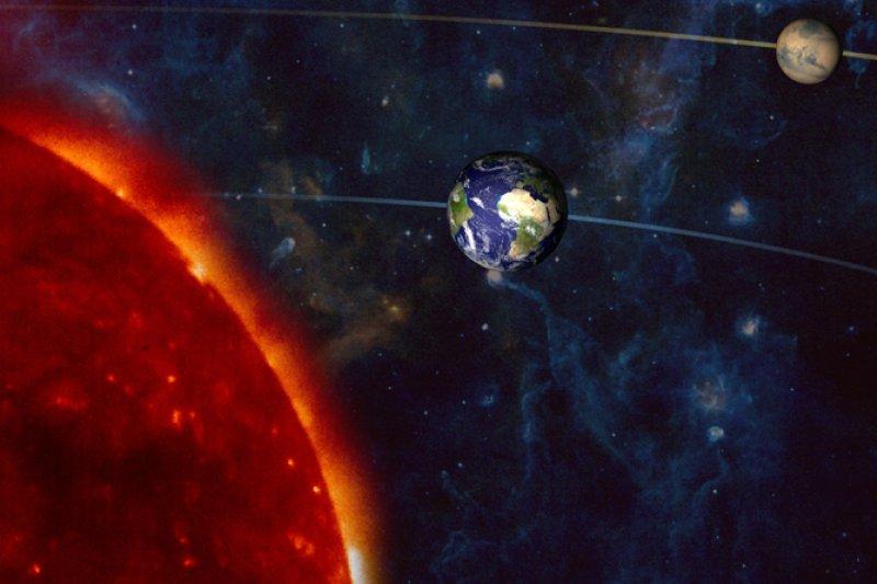 每26個月會出現一次「火星衝日」現象,此時火星最靠近地球。(翻攝NASA)