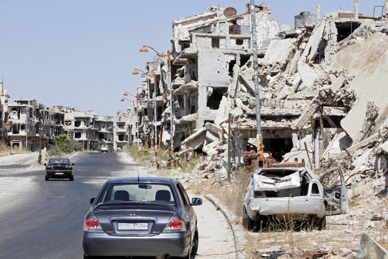敘利亞政府軍指責叛軍勢力違反停火協議,圖為荷姆斯飽經轟炸的街道。(美聯社)