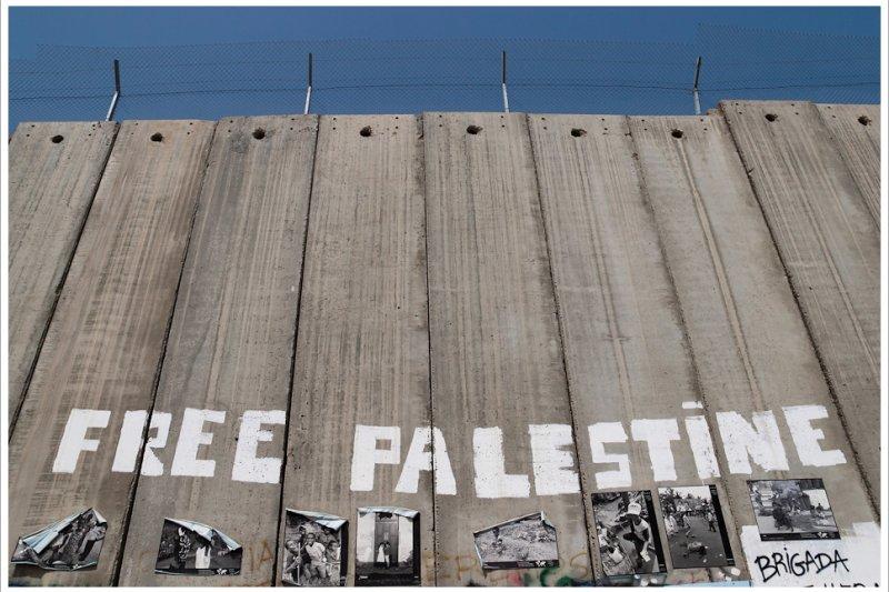以色列在巴勒斯坦地區築起隔離牆,川普也多次表示要築牆阻擋墨西哥移民。(圖/Wall_in_Palestine@flickr)