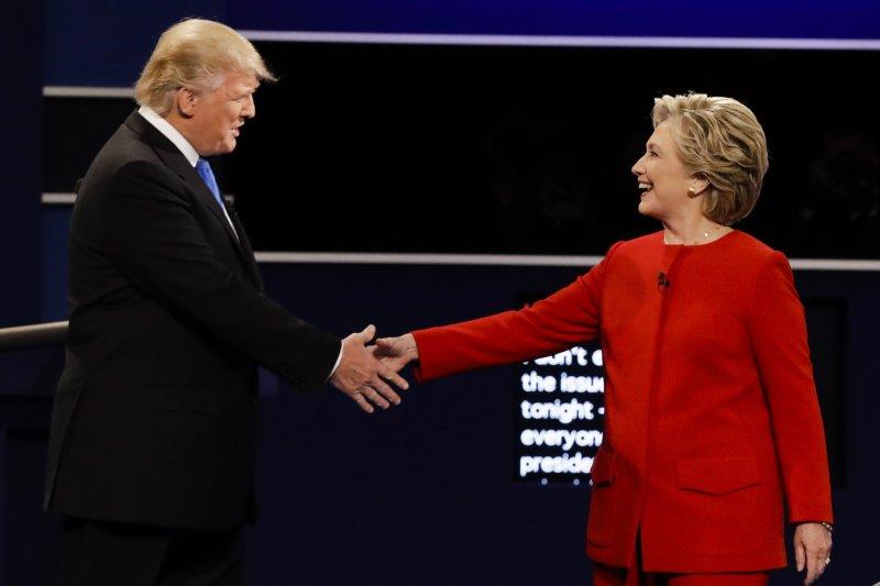 希拉蕊和川普首場電視辯論終於登場。(美聯社)