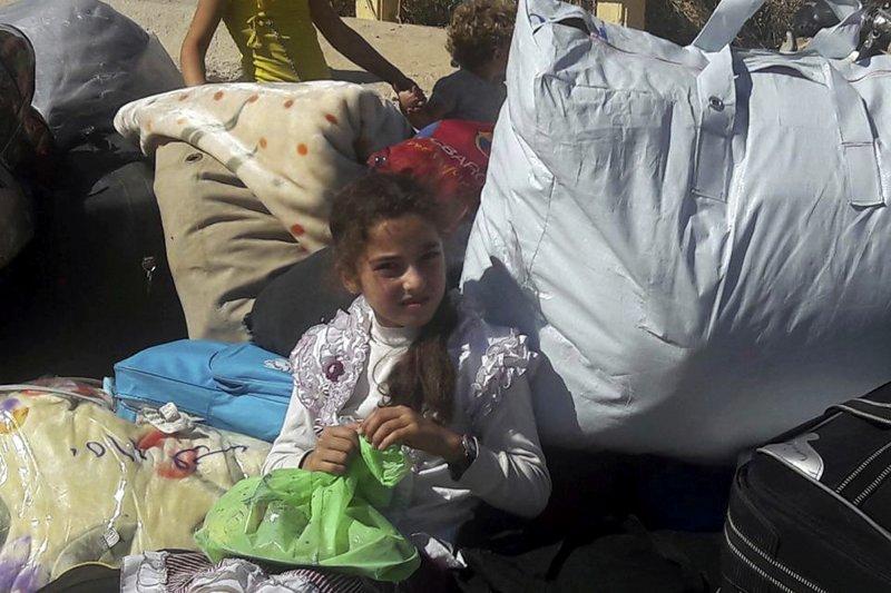 俄羅斯與敘利亞政府宣布提前實施「人道停火」,讓受困的阿勒坡居民和反抗軍可以撤離。(美聯社)
