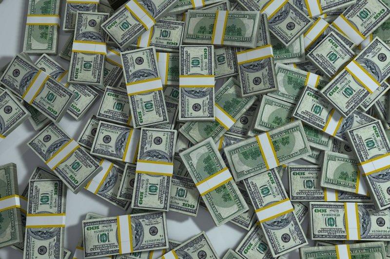 作者提出每人每月能夠得到1,000美元的「全民基本收入」政策。圖為美金示意圖。(資料照,取自Pixabay)
