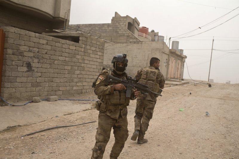 聯軍逼近摩蘇爾城下,伊斯蘭國領袖巴格達迪號召人民抵抗。(美聯社)