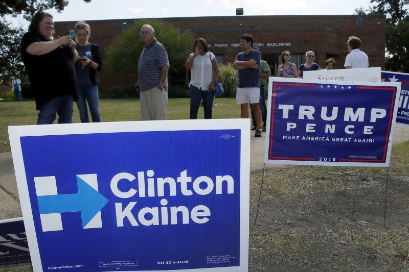 美國總統候選人希拉蕊(左)和川普(右)的競選標語(美聯社)