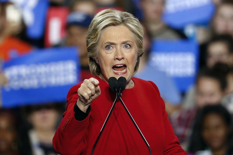美國民主黨總統候選人希拉蕊於投票前1天在密西根州造勢(美聯社)