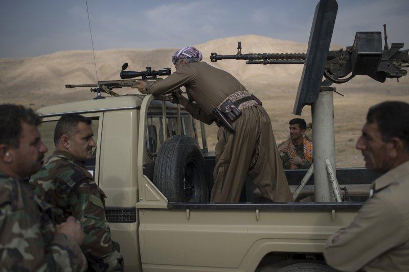 庫德族「敢死隊」在摩蘇爾鄰近村莊拜西加痛擊IS(美聯社)