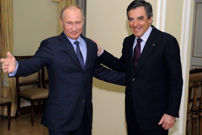 2013年費雍擔任法國總理期間造訪俄國,與當時俄國總統普京會晤。(美聯社)