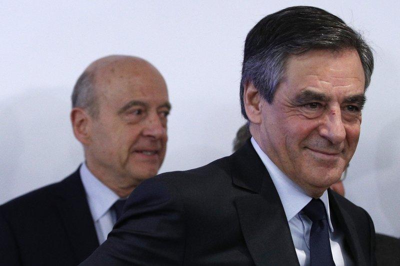 法國前總理費雍(前)擊敗居貝,贏得總統大選共和黨黨內初選。(美聯社)