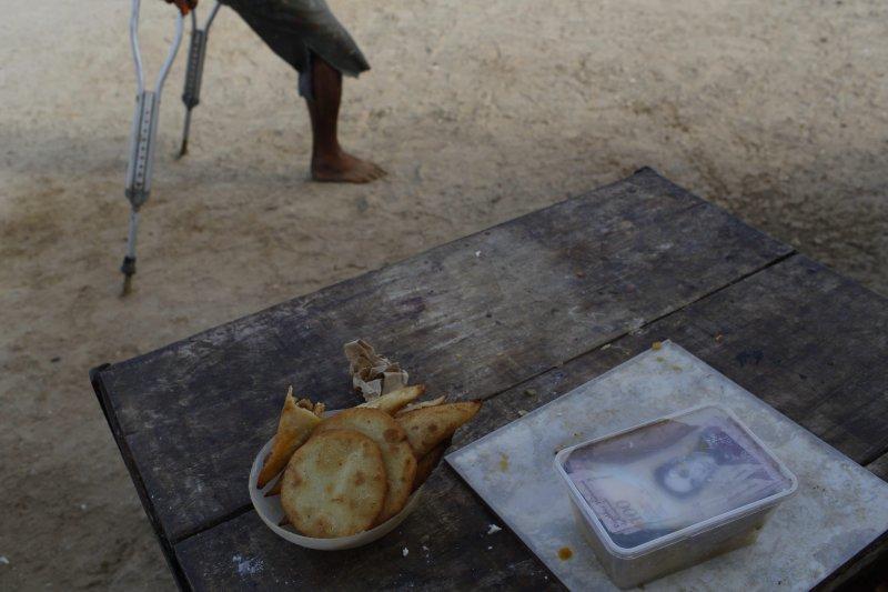 委內瑞拉通膨嚴重,民眾為了購買民生用品,往往得攜帶大量現金(AP)
