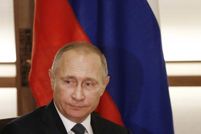 CIA認為,普京本人親自指示駭客攻擊希拉蕊陣營的網路。(美聯社)