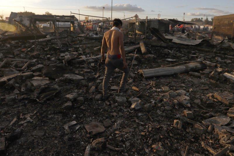 墨西哥圖爾特佩克市(Tultepec)的聖帕布立托(San Pablito)煙火市集爆炸,現場一片狼籍。(美聯社)