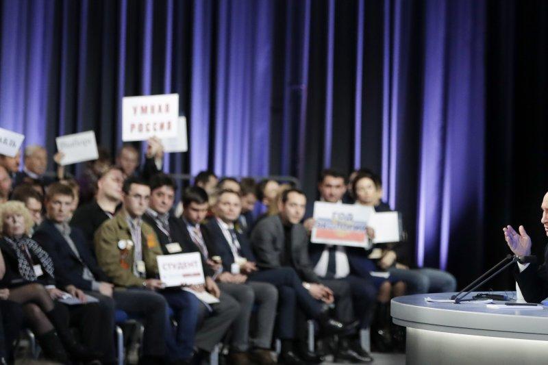 俄羅斯總統普京在年度記者會上發表談話,並回答國內外記者問題。(美聯社)