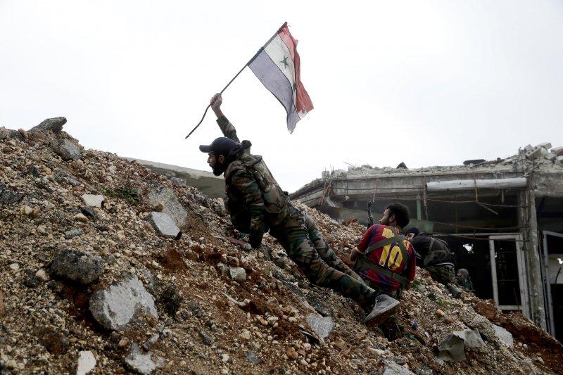 敘利亞大城阿勒坡攻防戰中的政府軍(AP)
