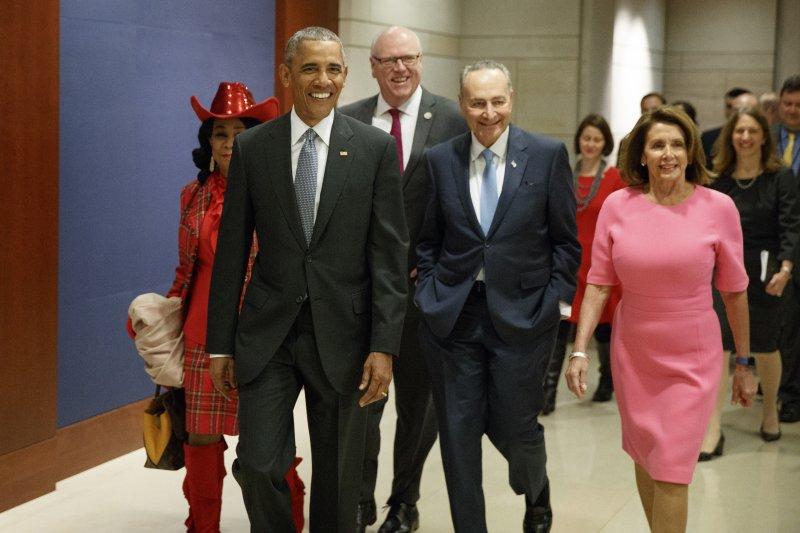 即將卸任的美國總統歐巴馬趕赴國會捍衛任內推動的健保法(AP)