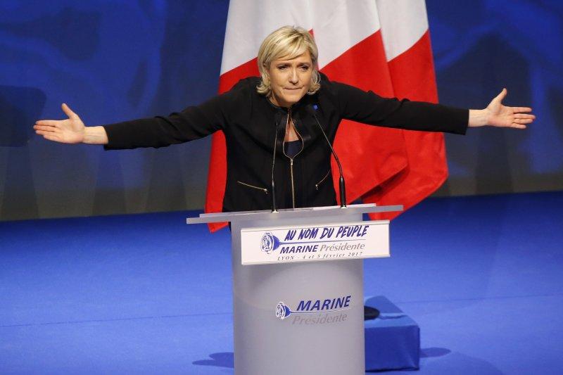 法國極右派總統候選人勒潘5日在中部大城里昂大談反全球化與反穆斯林等競選理念(AP)