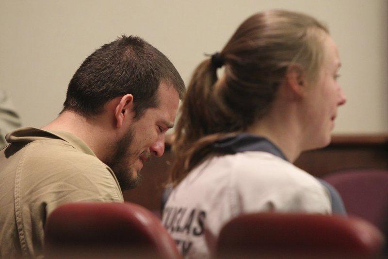 托雷斯(男)和諾頓(女)因為種族仇恨犯罪而被判處13年和6年徒刑(AP)