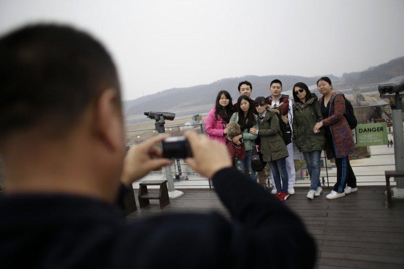 中國遊客是南韓旅遊業主力,一旦中國發動全面封殺,南韓經濟損失將非常可觀(AP)