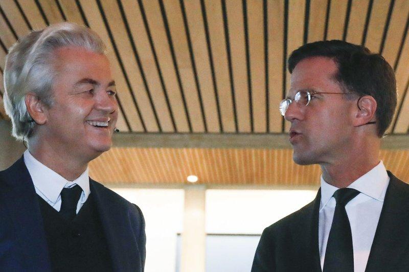 荷蘭國會大選:呂特(右)和威爾德斯(左)(AP)