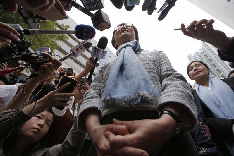 頂著僅27%民調支持度高票當選香港特首的林鄭月娥,未來的社會是否會日趨分裂?(AP)