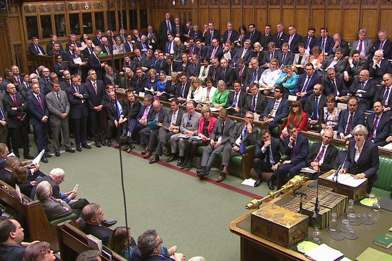 英國首相梅伊向下議院報告,正式啟動脫歐程序。(美聯社)
