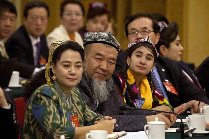 中國新疆和田地區教育局下令,今年9月開始全面禁用維吾爾語上課。(美聯社)